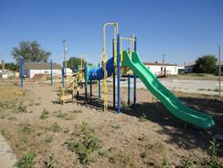 Weeds grow on an unused play ground on the southeast corner of 100 South and Broadway. - , Utah