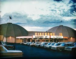 The marquee of the Cinedome 70 at twilight, with bright clouds in the background and rows of vintage cars in the foreground. - , Utah