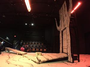 The set for <em>Winnie the Pooh</em> features a large tree decorated with a child's line art. - , Utah