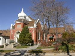 The former chapel is prominent on the left, while the theater entrance behind trees on right. - , Utah