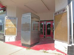In the middle of the theater entrance is a free-standing ticket booth.  There are poster cases on either side of the entrance and two sets of doors in the back. - , Utah