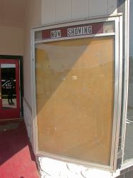 A poster case on the right side of the ticket booth. - , Utah