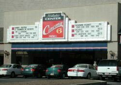 Marquee and attraction board for the Westates Holladay Center Cinema 6.  The ticket booth and entrance are below the sign. - , Utah