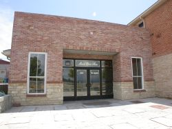 The current entrance of the Moroni Opera House is through a smaller building on the east side of the original structure. - , Utah