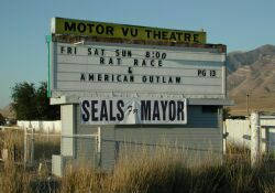 'Rat Race' and 'American Outlaw' on the sign of the Motor Vu Theatre in 2001. - , Utah