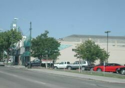 The Murray Theatre from the south side.  The entrance is behind the tree on the left and the roof of the auditorium can be seen on the right. - , Utah