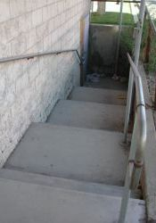 Stairs down to the north auditorium exit of the Murray Theatre.