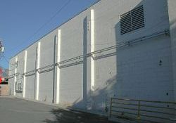 The north exterior wall of the Murray Theatre.  On the right are stairs down to the boiler room. - , Utah