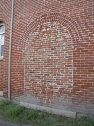 A bricked up doorway in the west exterior wall.  The doors were originally the doors were left open to provide ventilation during the hot summer months. - , Utah
