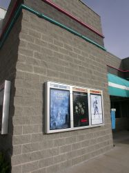 Poster cases and neon outside the Pointe Theatre  Above three poster cases outside the Pointe Theatre are bands of blue and pink neon that surround the theater. - , Utah