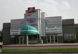 The Pointe Theatre has two entrances, one on each side of the ticket booth.  Above each set of doors is a three-line attraction board. - , Utah