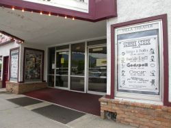 The entrance of the theater has two glass doors, with poster cases on either side.  The ticket booth (not shown) is on the right side wall of the entrance. - , Utah