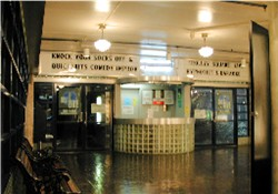 The original entrance of the Trolley Square Cinemas had a ticket booth in the middle with doors on either side. - , Utah