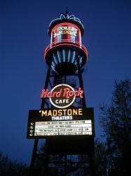 After Madstone Theaters remodeled the Trolley Square Cinemas in 2003, a new sign replaced the old Trolley Theatres sign on the water tower.  The sign for the Flick was replaced by one for the Hard Rock Cafe. - , Utah