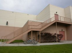 On the west side of the building is a stairway coming down from the projection booth. - , Utah