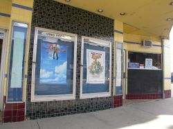 Underneath the theater's marquee are two poster cases and two long display cases. - , Utah