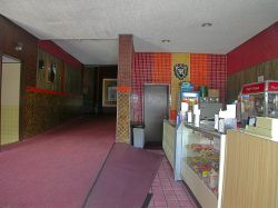 On the right side of the lobby is the concessions stand.  A hallway in the center of the lobby leads to the theater auditorium. - , Utah